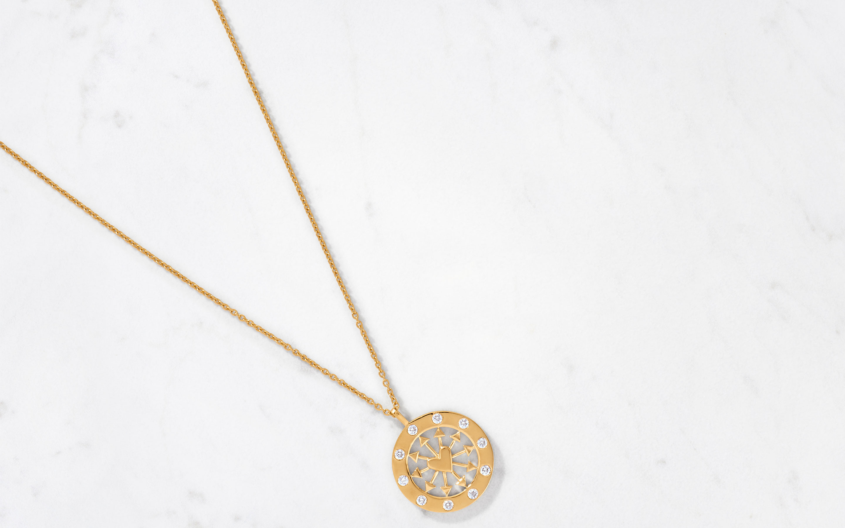 stylish medallion necklace with heart and arrow design made of 22 karat polished gold with round-cut diamonds