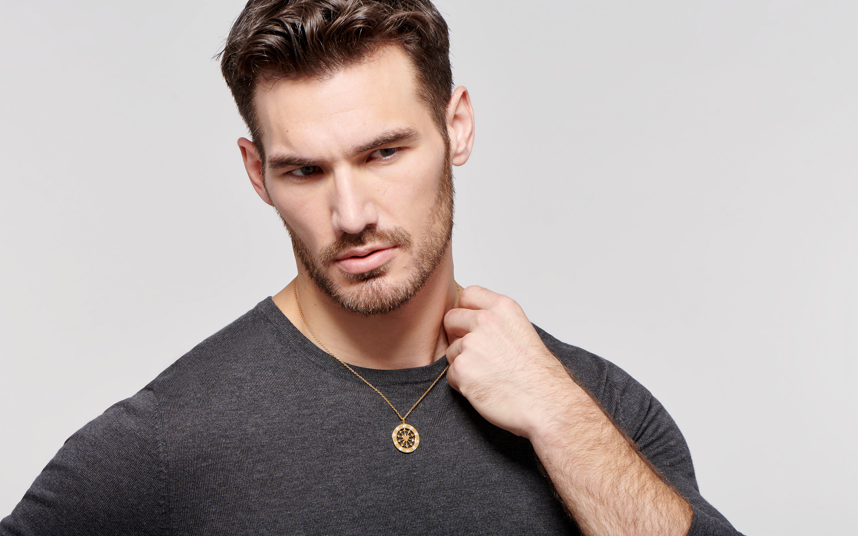 22 karat gold necklace with heart and arrows medallion in polished finish on bold male model