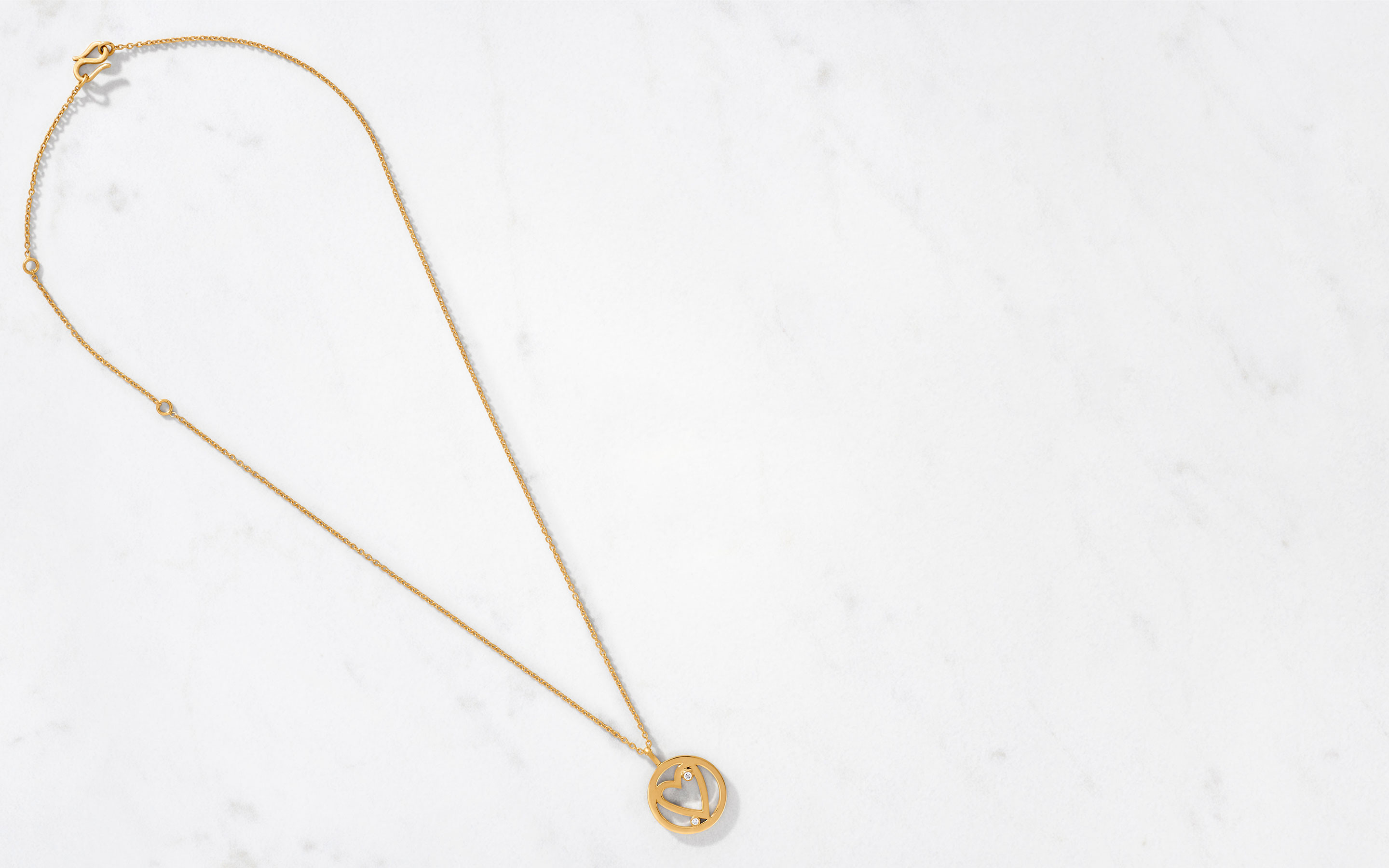 stylish charm necklace with open heart made of 22 karat polished gold