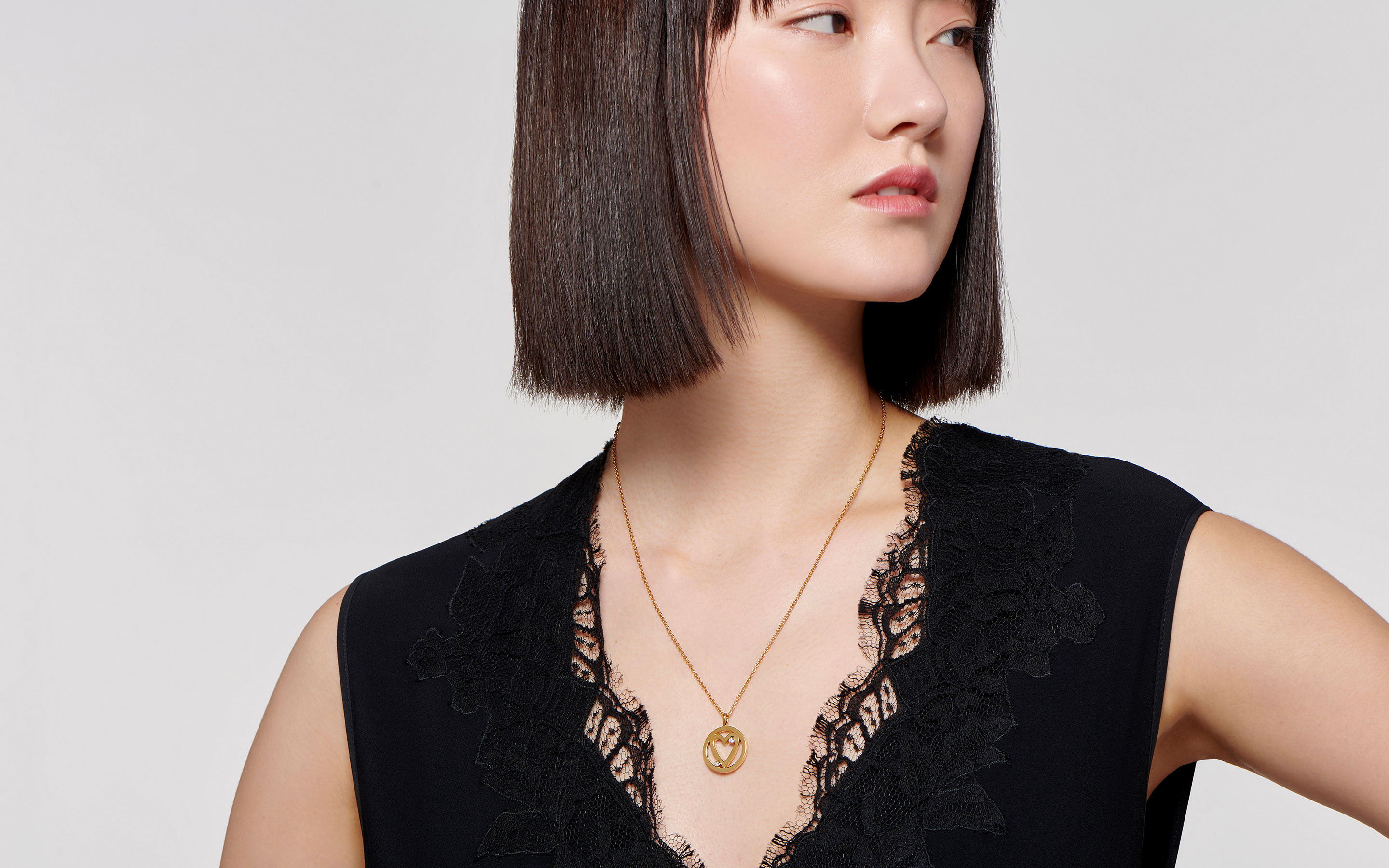 22 karat gold necklace with open heart pendant on fabulous East Asian model