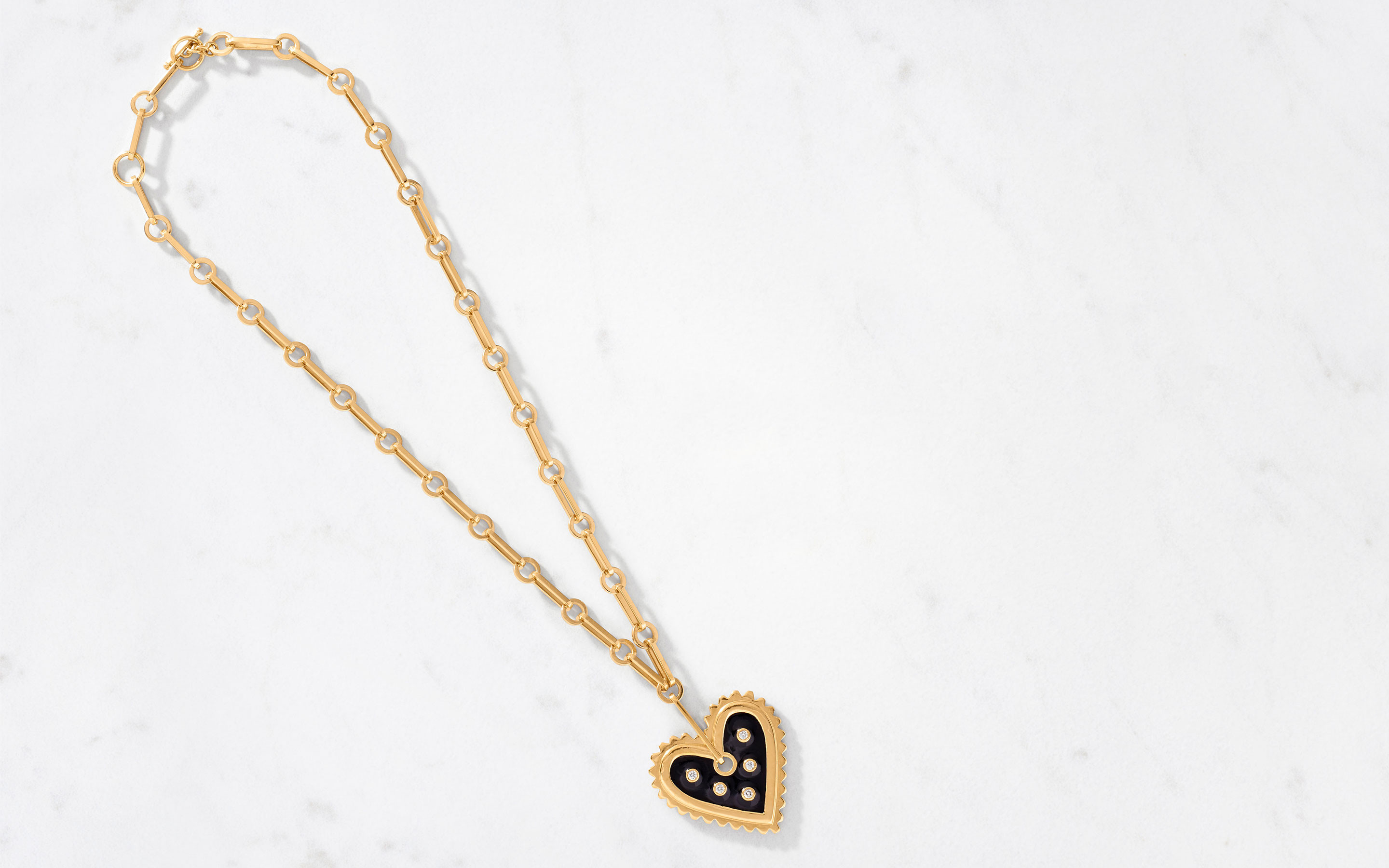 bold 22 karat gold necklace with heart pendant