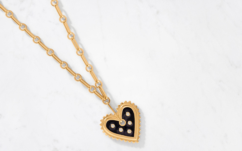 modish 22 karat gold necklace with heart pendant and diamonds