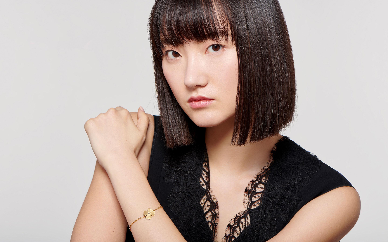 alluring model flaunting a 22 karat satin gold bracelet