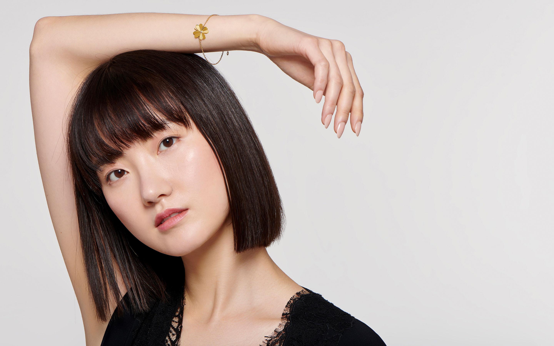 elegant 22 karat polished gold bracelet on beautiful resting brunette model