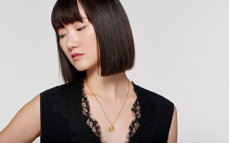 Asian model modeling chic satin 22 karat gold necklace