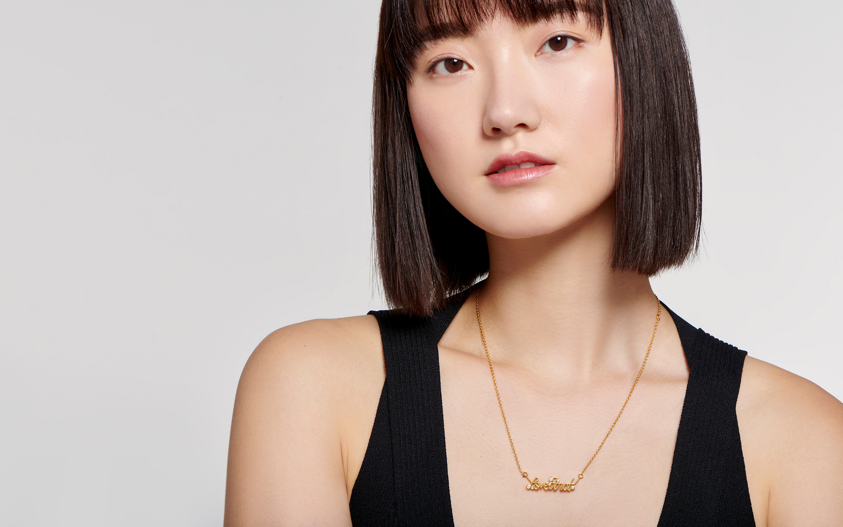 Asian woman donned in a lovely 242 karat polished gold necklace