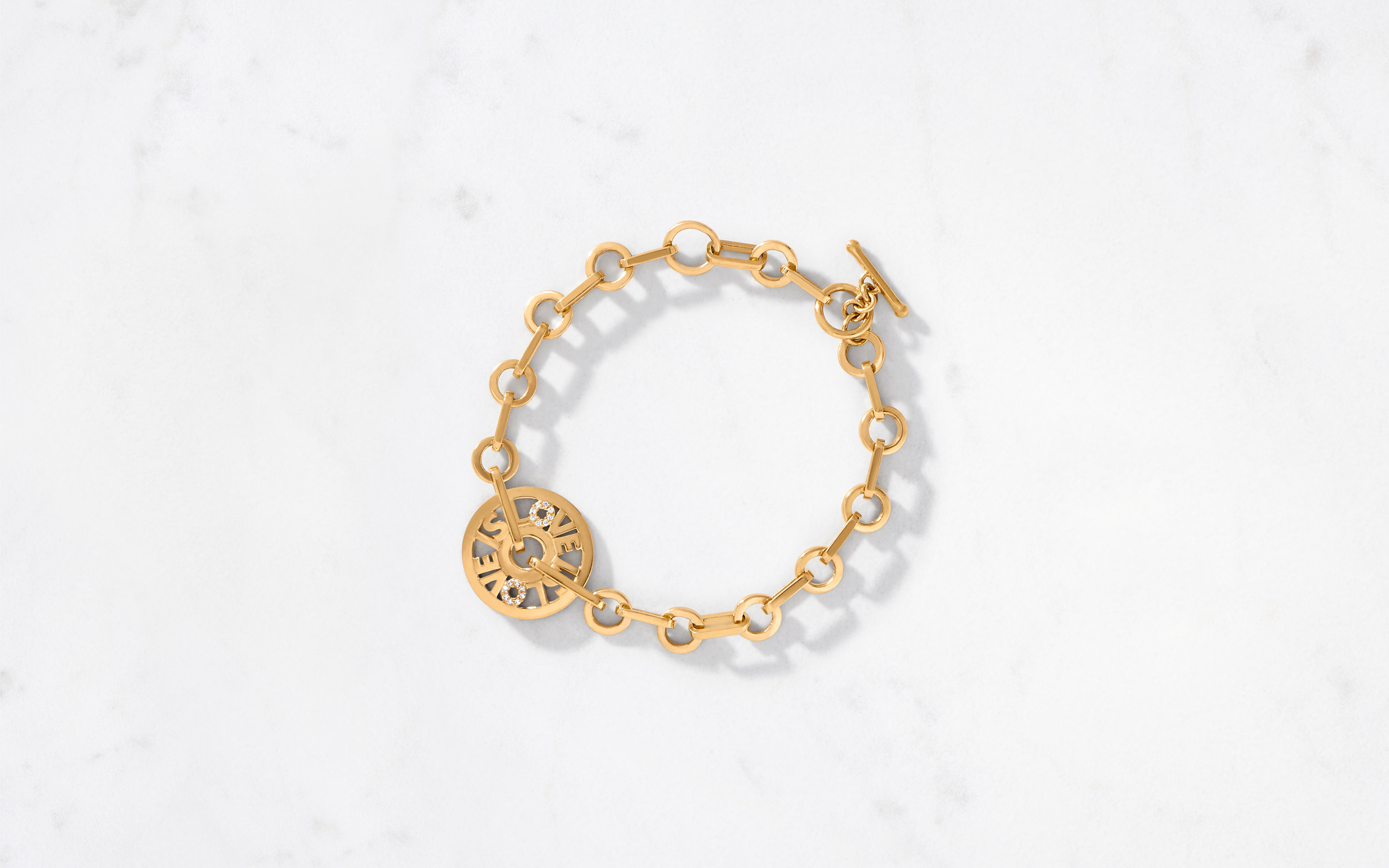 Brilliant gold love is love gold bracelet crafted out of 24 karat investment grade gold.