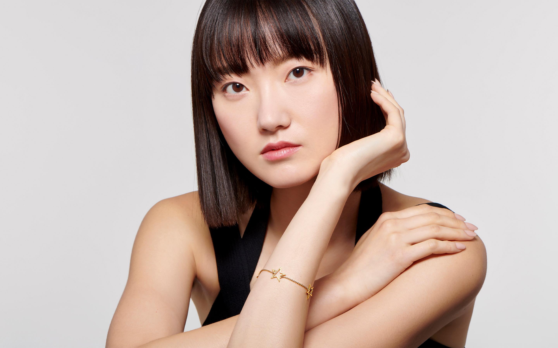 Woman model wearing 22 karat gold bracelet