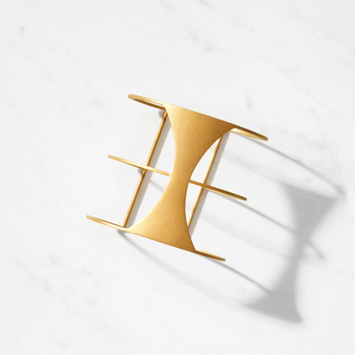 Callista Cuff is a sculpture for your wrist. Crafted from 22 karat matte gold with a gold weight of close to 60 grams, Callista signifies 'the most beautiful.' We would agree.