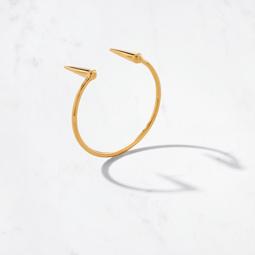 Our Dagger Cuff adorns your wrist with an edge. Handcrafted from 22 karat polished gold with a gold weight of around 27.5 grams. Dare to wear the sleek points facing inward or outward on this cool cuff.