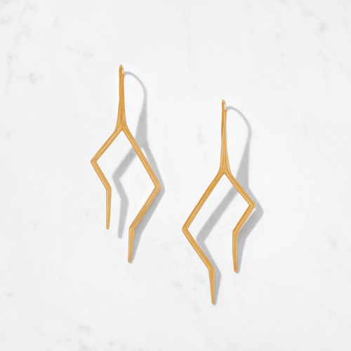 Electrify your look with the tall version of our Firebolt Earrings. Handcrafted from 22 karat polished gold, with a gold weight of around 18 grams, Firebolt's asymmetrical design signifies Mother Nature's random flashes of light.