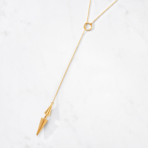 Our Double Cone Lariat Necklace finishes its edgy statement with a duo of spiky cones. Sleek and sophisticated in 22 karat polished gold with a gold weight of approximately 33 grams.
