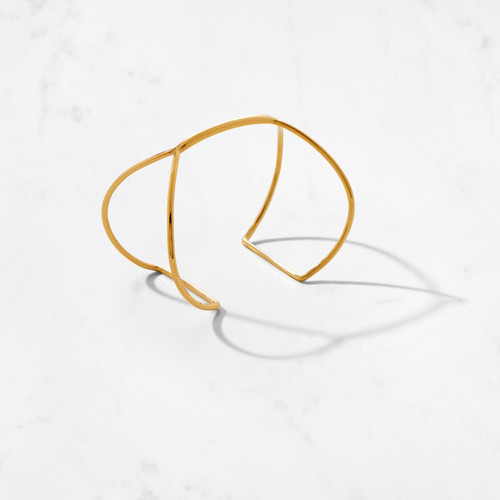 Our Butterfly Cuff is a modern and abstract representation of butterfly wings that appear to wrap gently around the wrist. Handcrafted from 22 karat polished gold with a gold weight of approximately 20 grams.