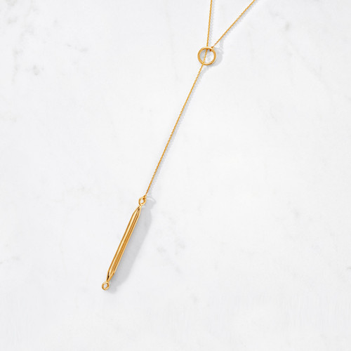 Our classic Lariat Necklace is adorned with a long, slender obelisk. Inspired by a shape adored by ancient civilizations, our modern take on the obelisk is handcrafted from 22 karat polished gold with a gold weight of approximately 23 grams.