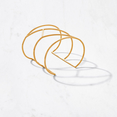 Get lost in the perfect geometry of our Tall Maze Cuff. Handcrafted in approximately 22 karat polished gold with a gold weight of approximately 35 grams, this spectacular statement bracelet is timelessly modern