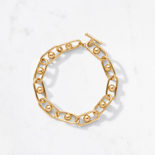Get in on the wrist action with Perigee Bracelet. Elliptical links orbit golden globes, each handcrafted in 22 karat polished gold with an approximate gold weight of 36 grams. Sexy. Substantial. For him and her.