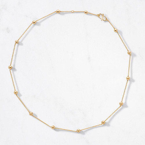 Tiny celestial bodies eternally linked. Pavo Necklace will hold you captive in its golden light. Handcrafted from 22 karat polished gold with an adjustable chain and an approximate gold weight of 10.5 grams.