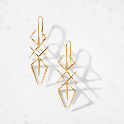 Inspired by the supernatural world of primitive arts, Arthropod Earrings make a bold and beautiful statement in 22 karat polished gold. Handcrafted with an approximate gold weight of 14 grams.