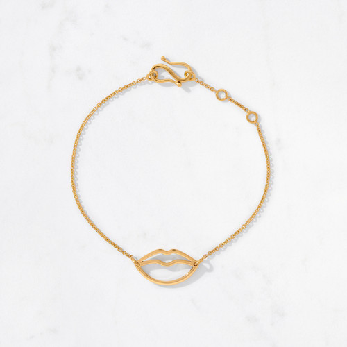 Pucker up! Our Lips Bracelet from the whimsical Talisman Collection bestows a delicate golden smooch on your wrist. Beautifully handcrafted from 22 karat gold with a gold weight of approximately 4.4 grams.