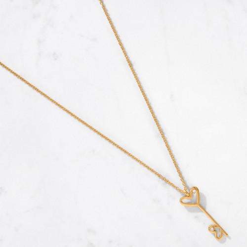 Unlock the mysteries of your heart with our 22 karat polished gold Double Heart Key Pendant handcrafted from approximately 6.8 grams of gold. Set with a duo of diamonds, our take on the classic key motif is a beautiful way to say 'I love you.'