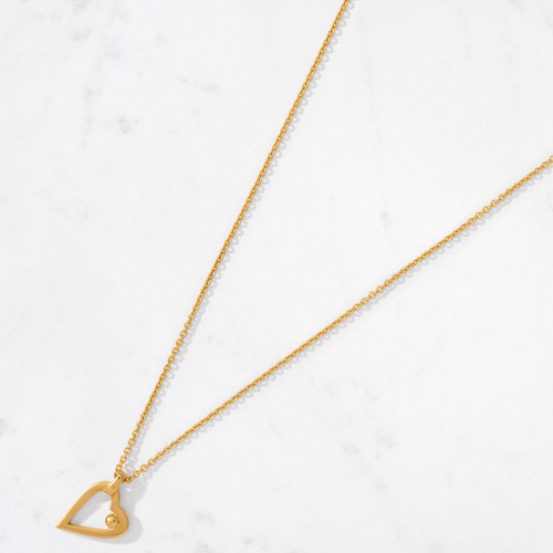 You've got a heart of gold! Handcrafted in 22 karat polished gold with a gold weight of approximately 7.3 grams, our Heartbeat Necklace hangs in perfect sync over your own beating heart.