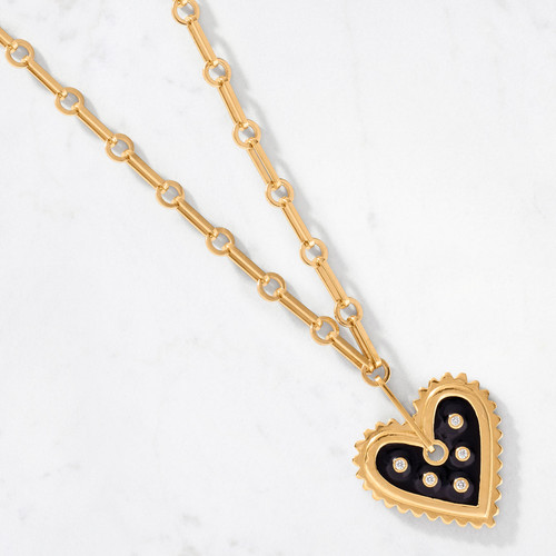 Inspired by Milagro charms, our Bold Heart Diamond/Black Enamel Pendant is an ode to bold love. Black enamel surrounds five round cut diamonds at the heart of the pendant. Handcrafted from 22 karat gold with an approximate gold weight of 80 grams.
