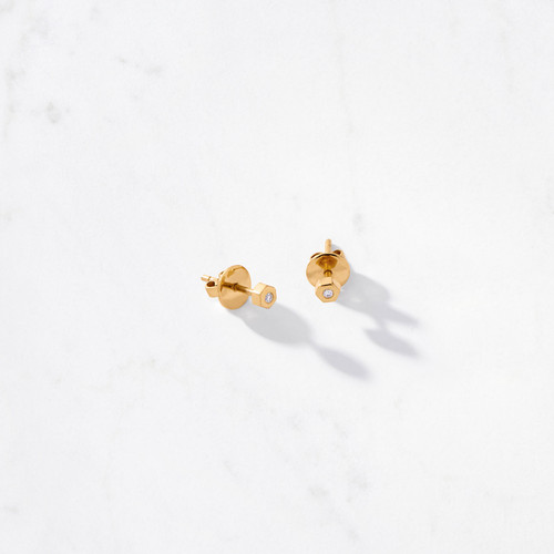 What's your angle? We're partial to the six-side polygon, especially when it has a sparkling diamond in its center. Our Hexagon Diamond Stud Earrings, with a gold weight of approximately 1.78 grams, are handcrafted from solid 22 karat gold.