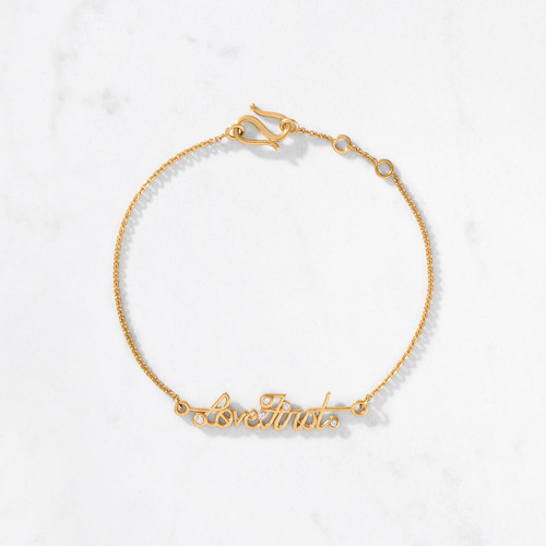 Feel it, say it, wear it. Love always comes first. From our Scribe Collection, the Love First Bracelet is a delicate expression of our most expansive sentiment. Beautifully handcrafted from 22 karat polished gold with a gold weight of approximately 4.6 grams and set with five brilliant cut diamonds.