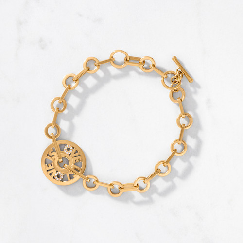 What you wear speaks volumes, so why not get right to the point? Our Love is Love Bracelet spells it out loud and proud. Crafted by hand from solid 22 karat gold with an approximate gold weight of 27.5 grams. We've added a splash of diamonds for sparkle.