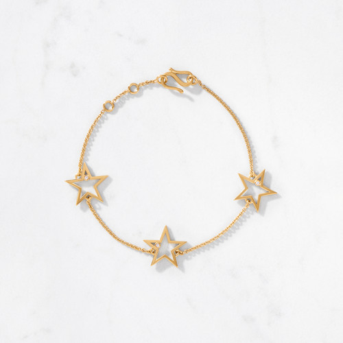 Be stellar and reach for the stars! Sparkling round cut diamonds are nestled inside a trio of bold, graphic stars connected along a delicate strand of gold links. Our gleaming 3 Star Bracelet is handcrafted from solid 22 karat gold with a gold weight of approximately 5.25 grams.