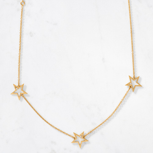 We're seeing stars! A constellation of bold and graphic stars are connected by a delicate chain of gold links to form our 3 Star Necklace. A tiny round cut diamond is nestled in each star for a touch of sparkle. Handcrafted from solid 22 karat gold polished to a high gleam with an approximate gold weight of 7.1 grams.