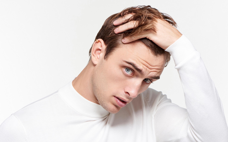 Man model wearing 22 karat gold earring