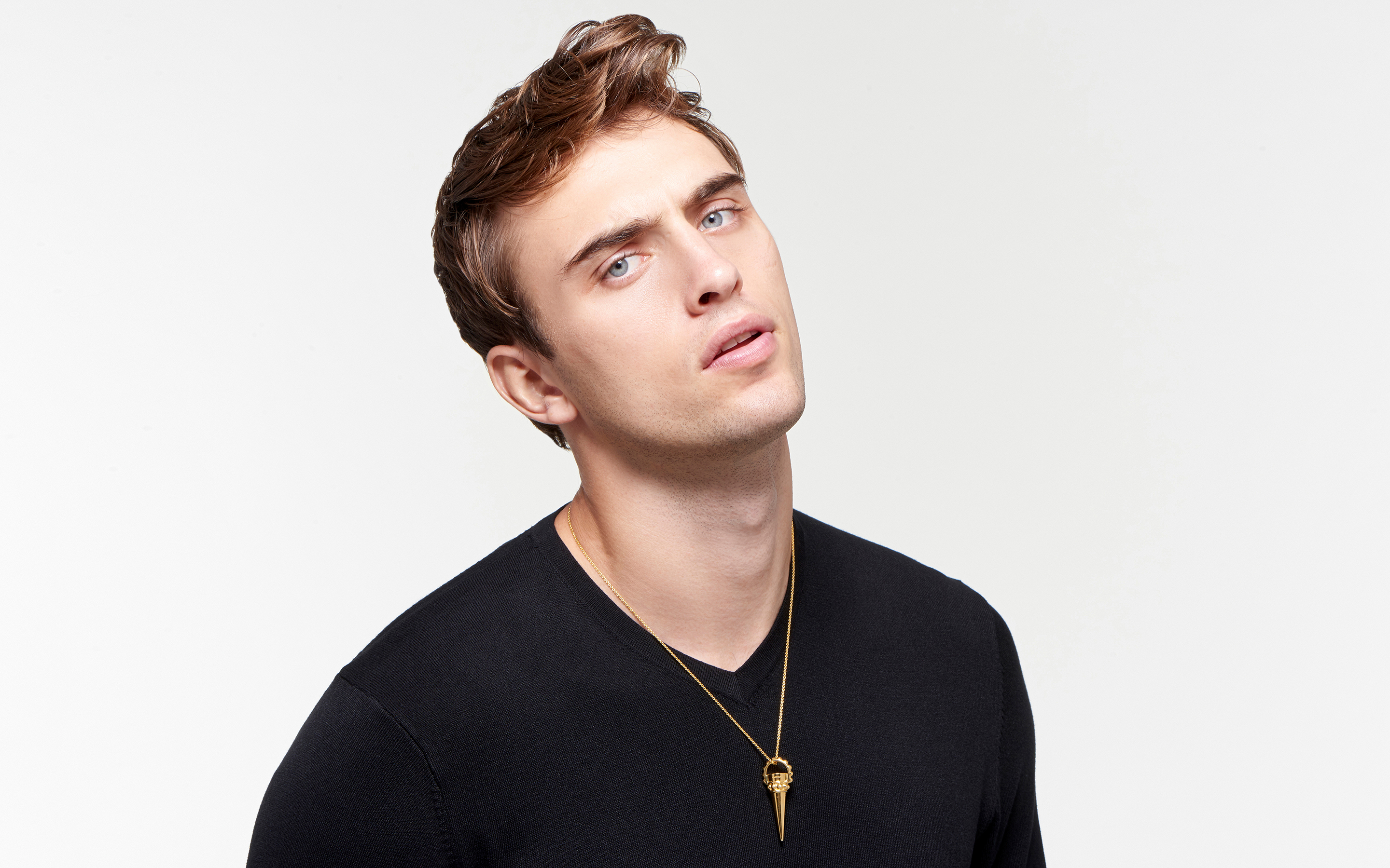 22 karat gold cone necklace on male model