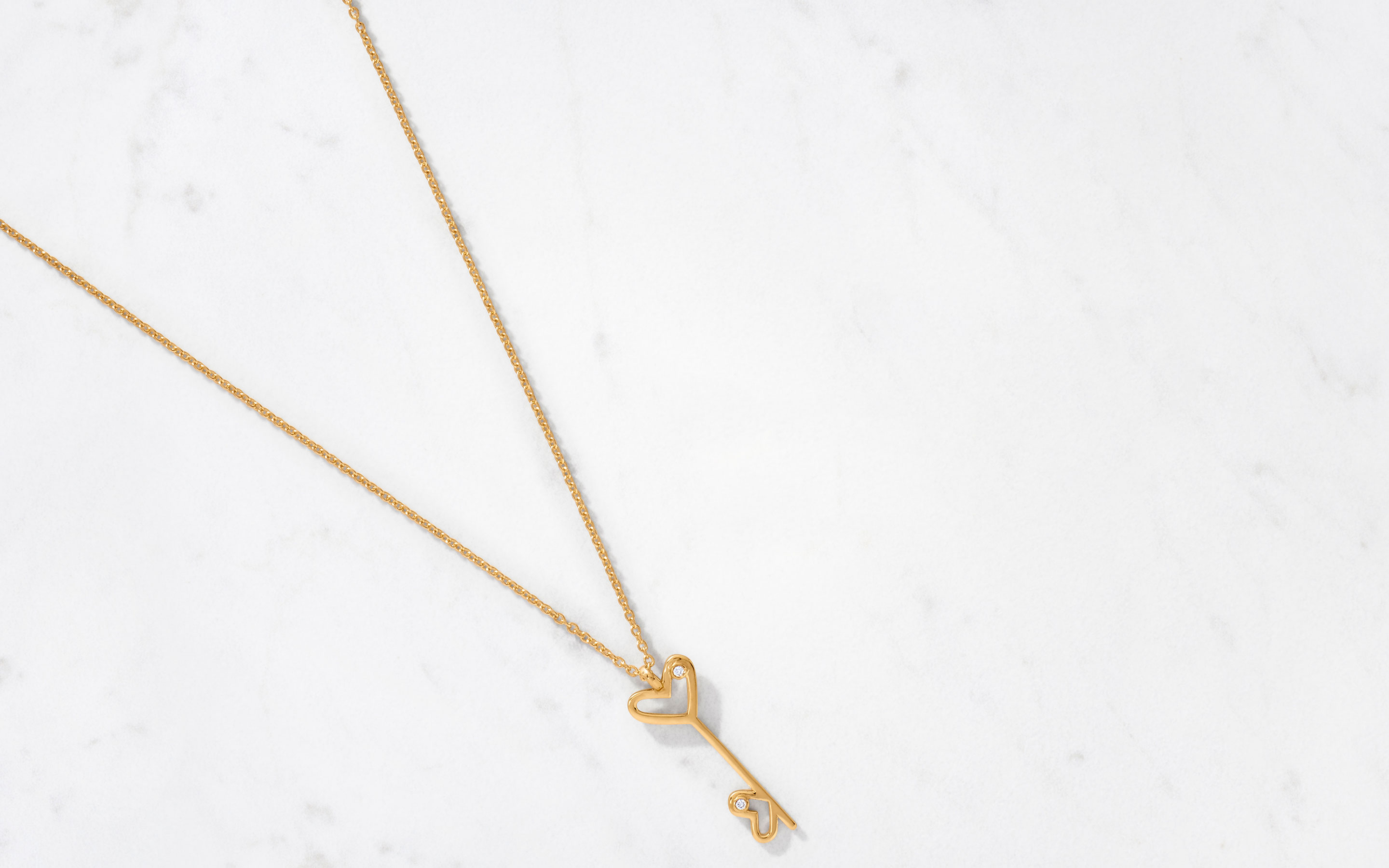 22 karat gold necklace with whimsical double heart charm in polished finish