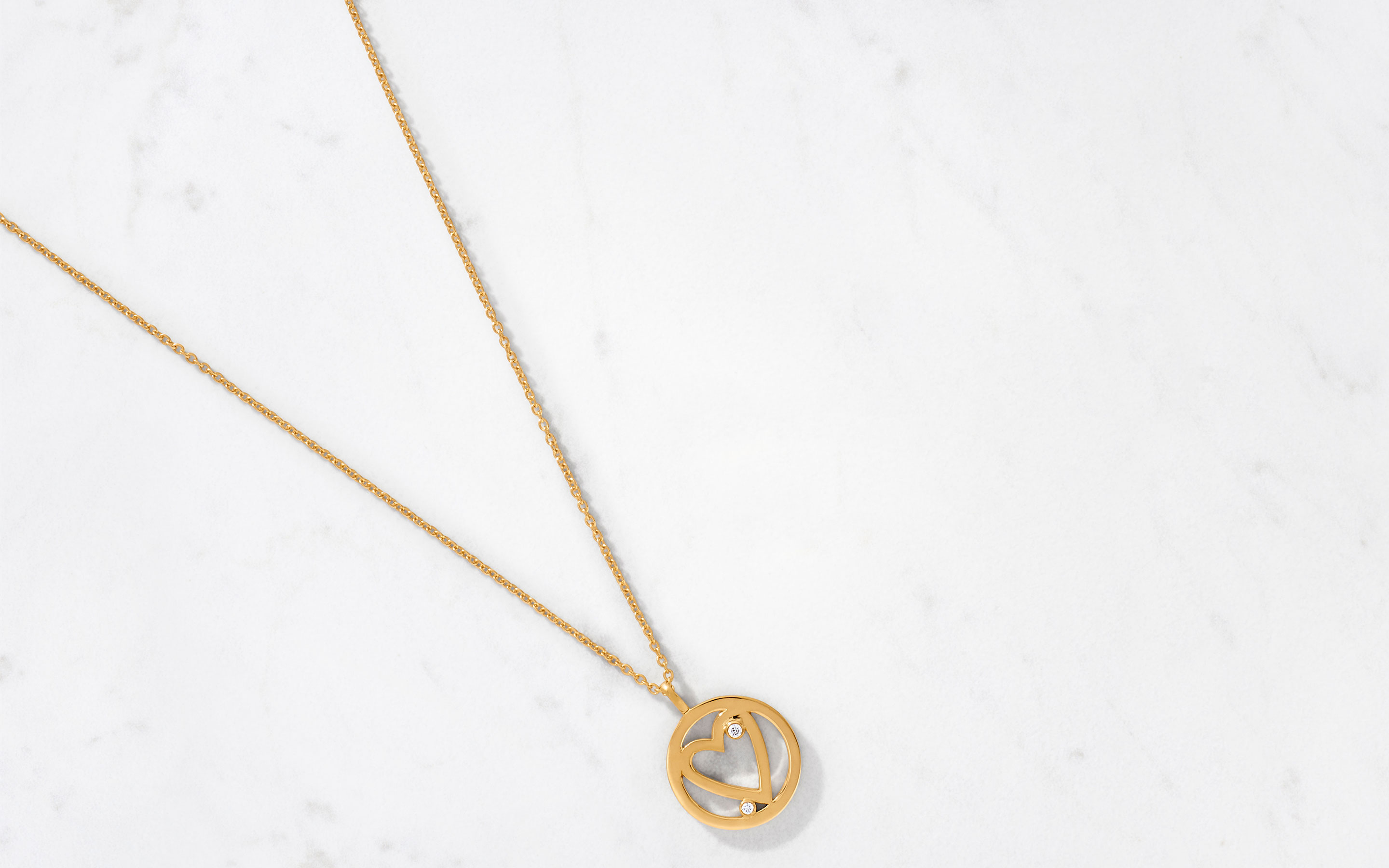 sleek necklace with open heart pendant made of 22 karat polished gold