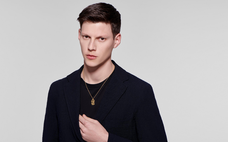 Male model wearing 22 karat gold necklace