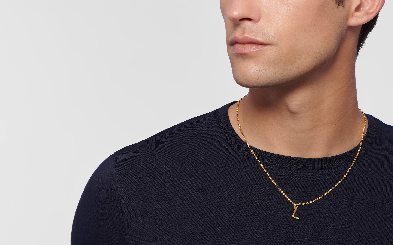 Male model wearing 22 karat gold alphabet pendant