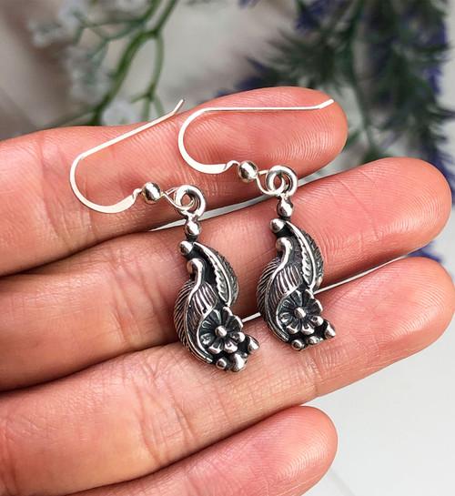 Sterling silver drop earrings.