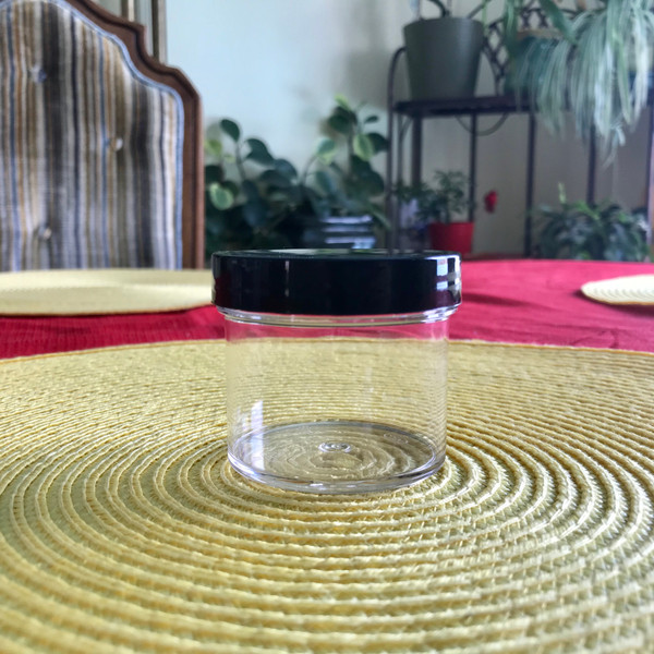 2 ounce clear plastic jar with lid