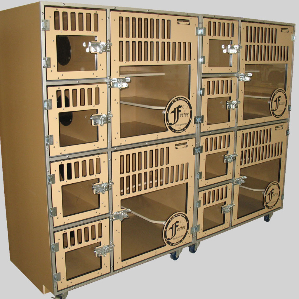 Cat kennels with litter-box area.