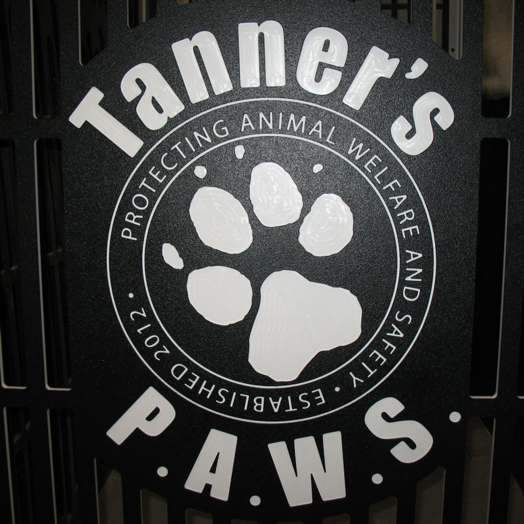 Tanners PAWS Logo on kennel gates.
