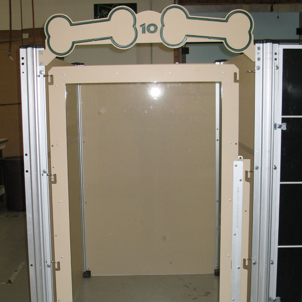 Custom dog kennel with tempered glass door.