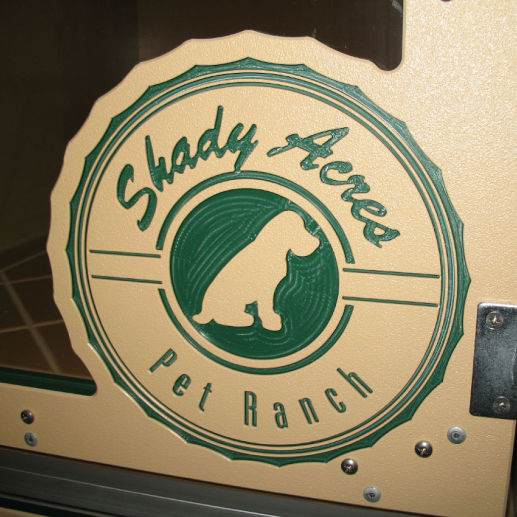 Shady Acres Pet Ranch Logo engraved on kennel gate.