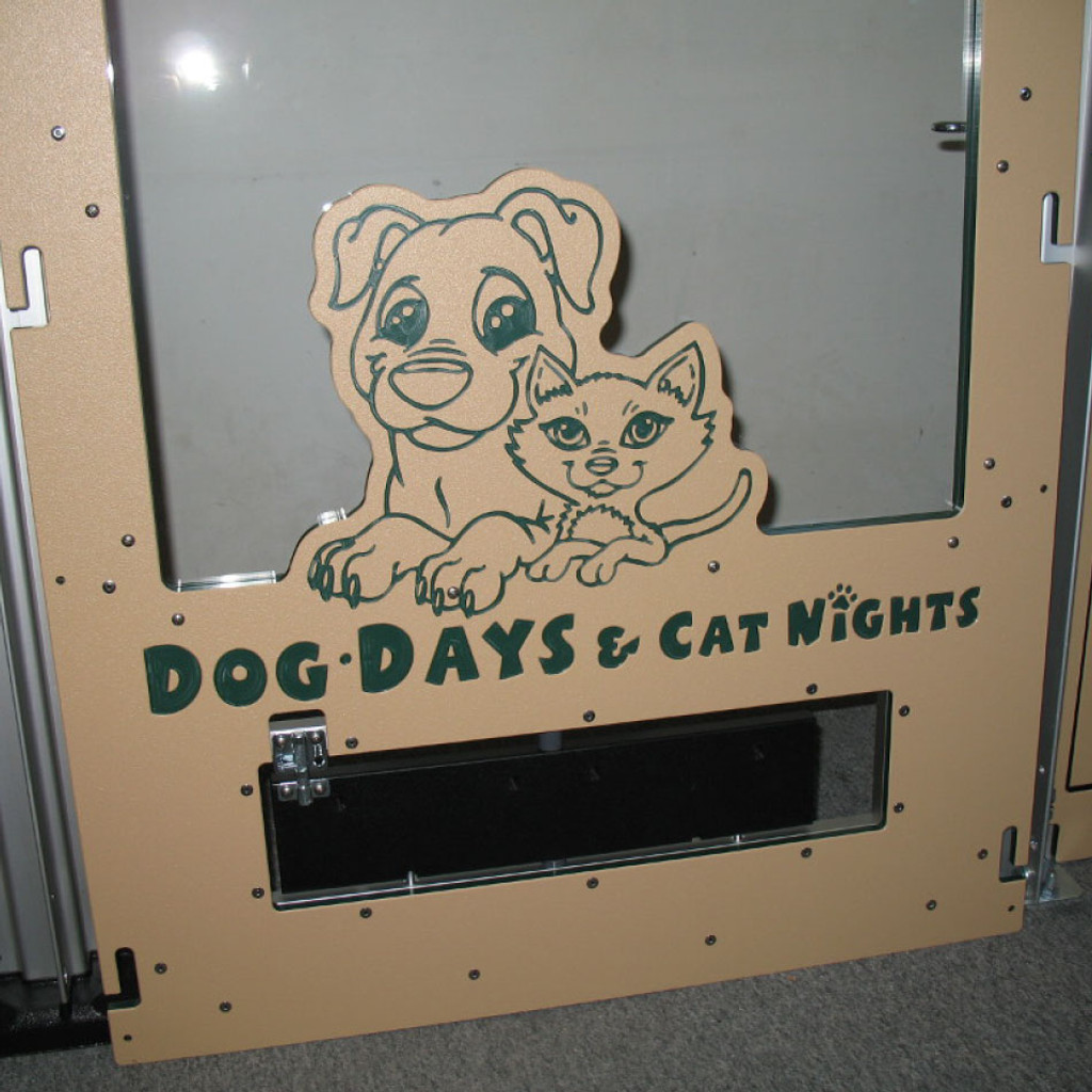 Dog Days & Cat Nights Logo engraved on the dog kennel gate.