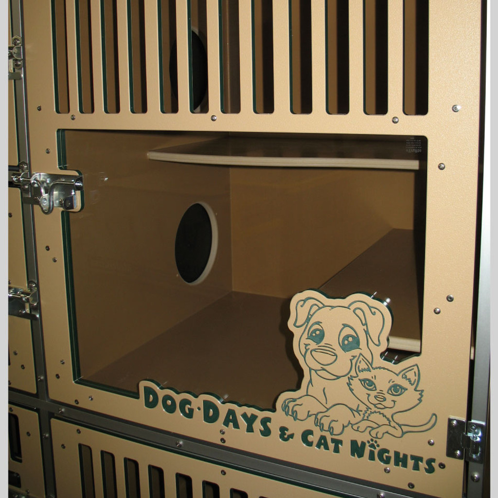 Dog Days & Cat Nights Cat condo unit with glass.