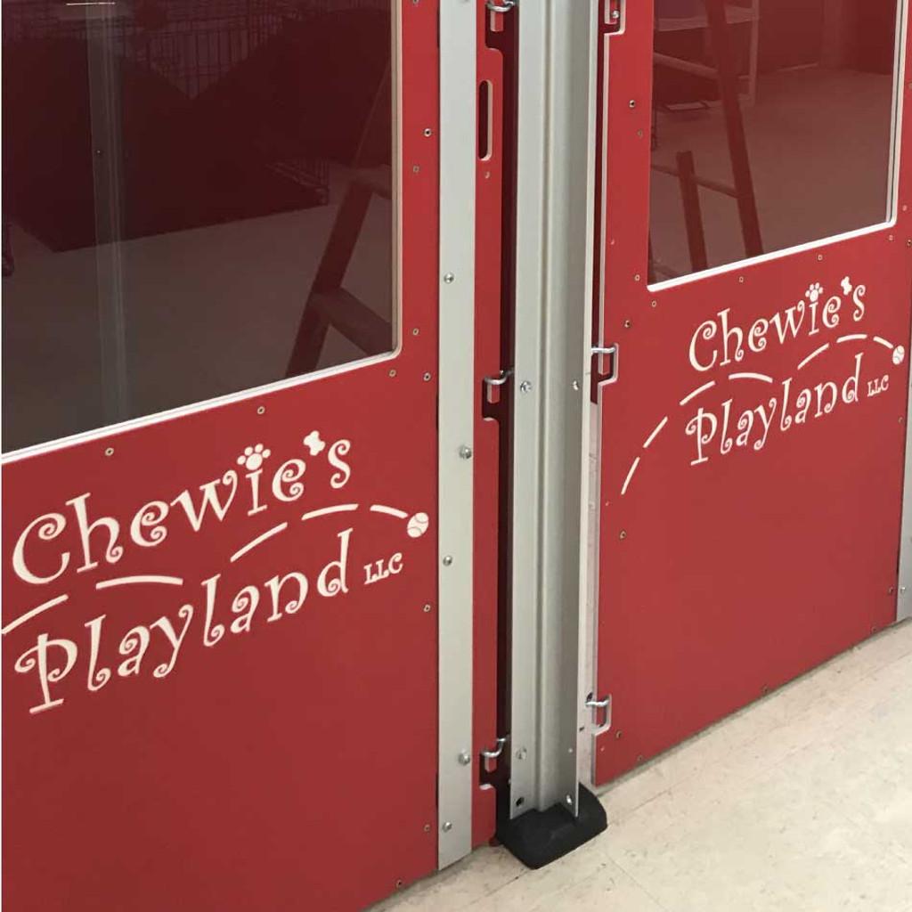 Chewie's Playland's gates with custom logo.
