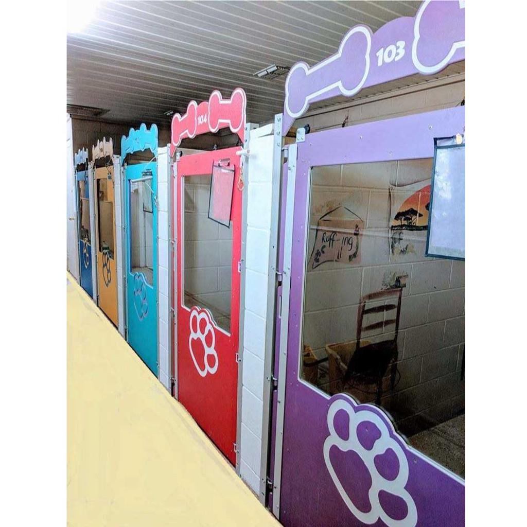 Colorful dog kennel gates for Mugus Pet Resort.