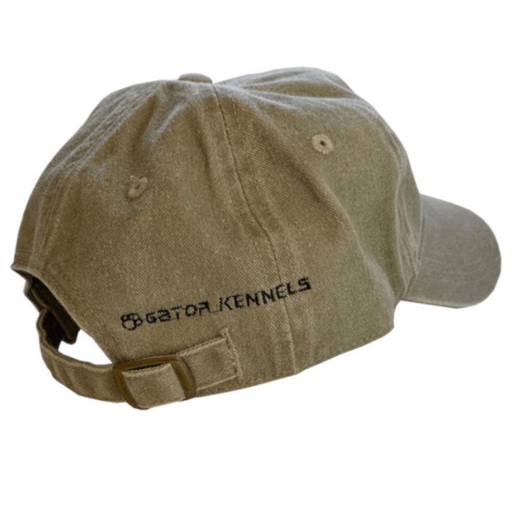 The Gator Kennels logo modestly embroidered on the back of the tan hat.