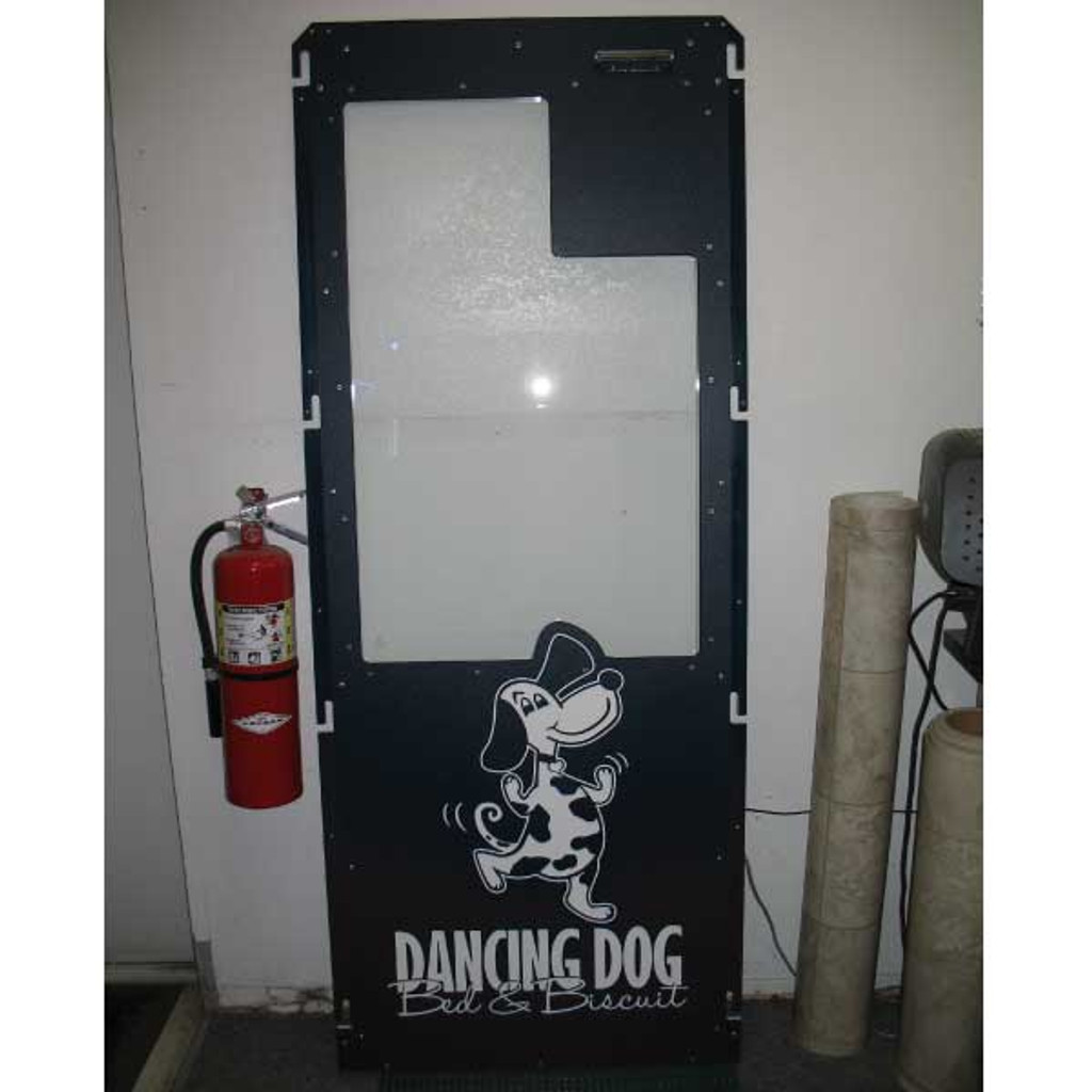 Dancing Dog Bed & Biscuit navy kennel gate with custom logo.