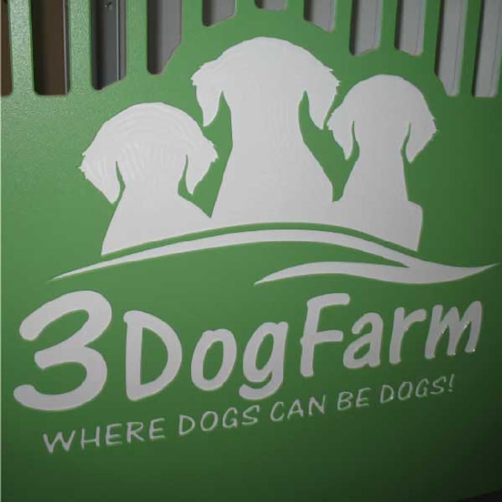 3 Dog Farm custom logo on their kennel gate.